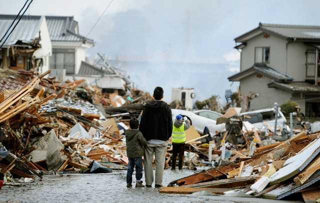 報道写真が語る東日本大地震の光...