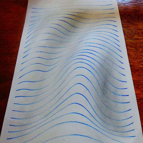 巧みに描かれたノートの罫線で立体的に見える3Dイラストアート